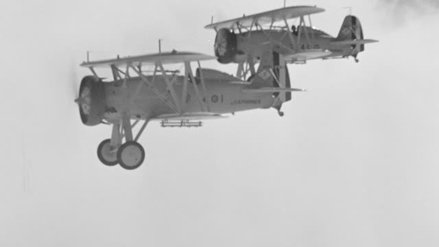 ms aerial ts air to air shot of two biplanes in flight above clouds - air to air shot stock videos & royalty-free footage