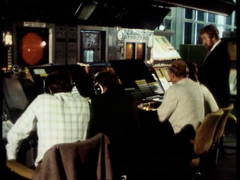 air traffic air traffic lib london west drayton int air traffic controllers sitting before elderly radar equipment screens on display - air traffic control stock videos & royalty-free footage