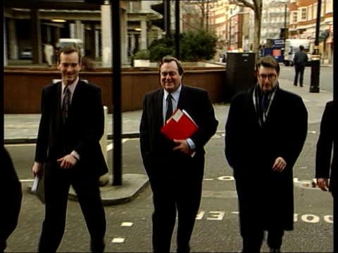 mps rebel itn england london john prescott mp towards past across road into building with advisers int bv prescott away through foyer track ms... - air traffic control点の映像素材/bロール