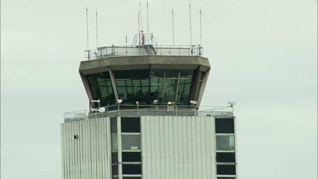 POV Air traffic control tower seen from airplane taxiing at Basel Airport, Switzerland
