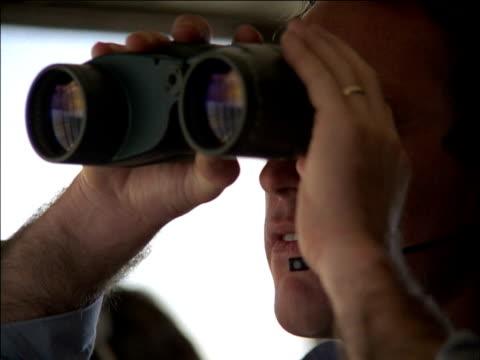 air traffic controller at work using binoculars - air traffic control operator stock videos & royalty-free footage