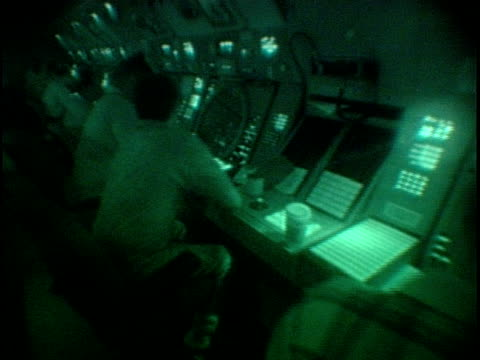 vídeos de stock, filmes e b-roll de ms, pan, air traffic controllers at work stations,  dulles international airport, dulles, virginia, usa - 2001