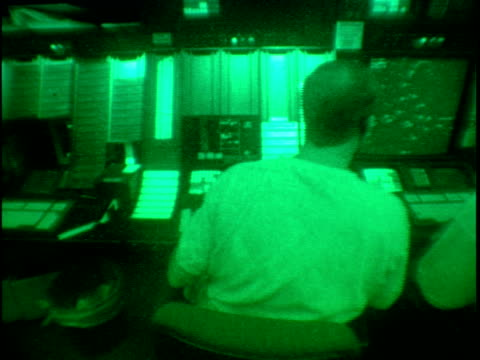 ms, pan, air traffic controllers at work stations, rear view, atlanta hartsfield international airport, atlanta, georgia, usa - night vision stock videos and b-roll footage