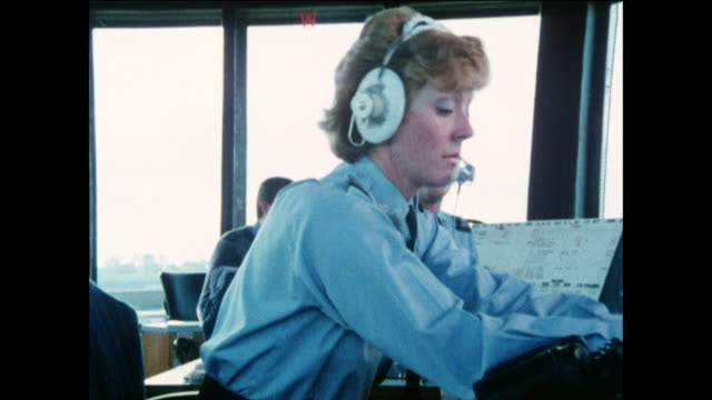 montage air traffic controllers clearing planes for takeoff / united kingdom - captain stock videos and b-roll footage