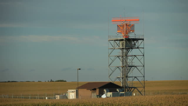 air traffic radar at airport surrounded by a cornfield - air traffic control tower stock videos & royalty-free footage