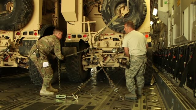 air transportation specialists load and secure oshkosh mine resistant ambush protected vehicles and cargo onto a c-17 at the 332nd air expeditionary... - us airforce stock videos & royalty-free footage