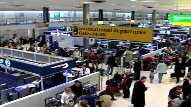 new excess baggage fees high angle view of passenger terminal pan - fee stock videos and b-roll footage