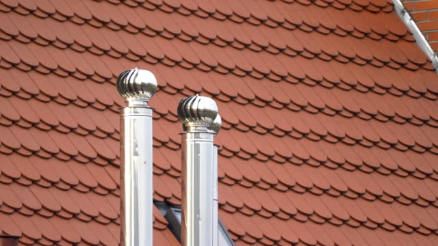 air ventilator on the roof in 4k - roof tile stock videos & royalty-free footage