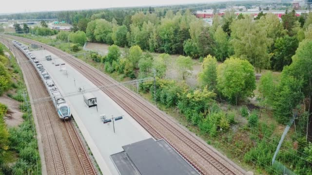 Air view of departing commuter train, at trainstation Helenelund, Sollentuna, Stockholm
