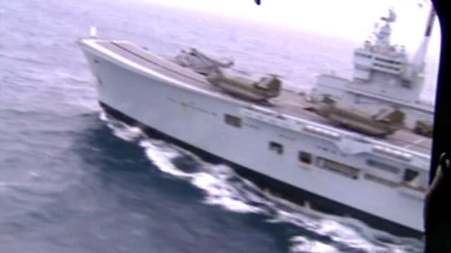 air view of hms ark royal during the second gulf war ext coffins of crew members killed after helicopter collision on deck draped in flags coffin... - coffin stock videos & royalty-free footage