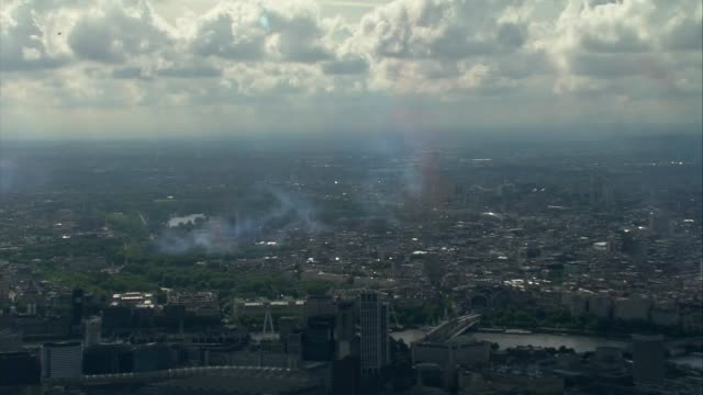 air views of london and world war ii flypast; england: london: ext air view flypast of red arrows and la patrouille de france with red, white and... - world war ii stock-videos und b-roll-filmmaterial