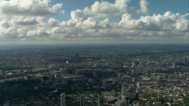 air views of london and world war ii flypast; england: london: ext air view central london / british flag flying from victoria tower / the shard and... - world war ii stock-videos und b-roll-filmmaterial
