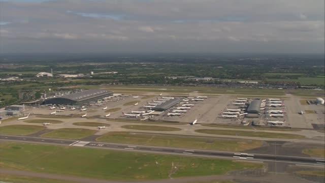 air views of london bridge station, gatwick airport and heathrow airport; london: heathrow: air view lakes / wide shot runway / virgin planes on... - gatwick airport stock videos & royalty-free footage