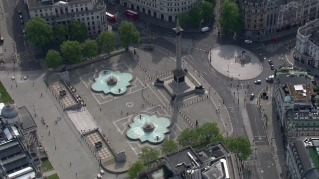 air views of london landmarks; england: london: ext air views / aerials houses of parliament and the london eye / trafalgar square, admiralty arch,... - famous place stock videos & royalty-free footage