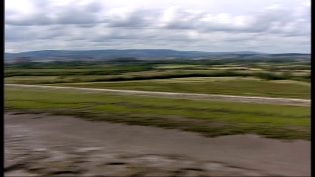 air views of severn estuary and surrounding area; air views / aerials of newport wetlands marshland on coast between second severn crossing and... - estuary stock videos & royalty-free footage