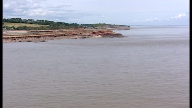 air views of severn estuary and surrounding area more air views / aerials of coastline between penarth and sully where the mouth of the severn is... - river severn stock videos & royalty-free footage