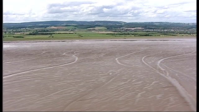 air views of severn estuary and surrounding area more good air views / aerials of second severn crossing bridge mudflats at low tide including flock... - river severn stock videos & royalty-free footage