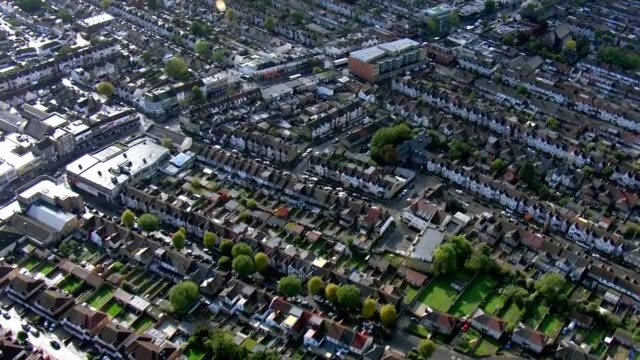 air views of west london; england: london: west london: ext aerial suburban area / zoom in residential housing estate with semi-detached houses with... - residential district stock videos & royalty-free footage