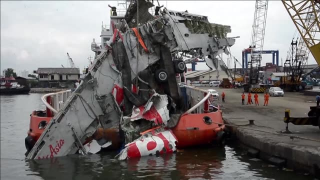 airasia flight qz8501 from the indonesian city of surabaya to singapore plunged into the ocean on december 28 2014 killing all 162 people on board - surabaya stock videos & royalty-free footage