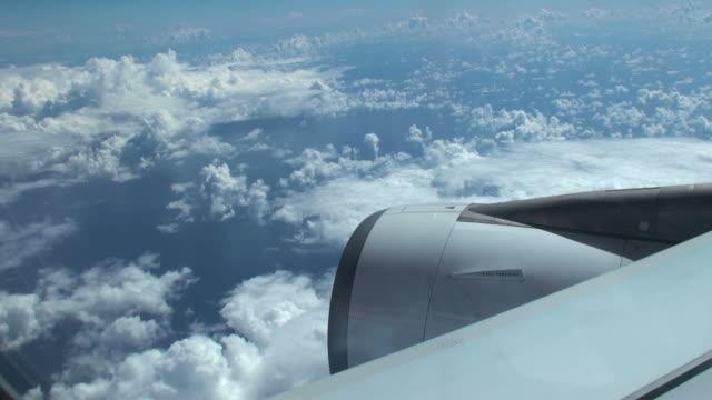 airborne plane flying among white soft clouds - vidbild bildbanksvideor och videomaterial från bakom kulisserna