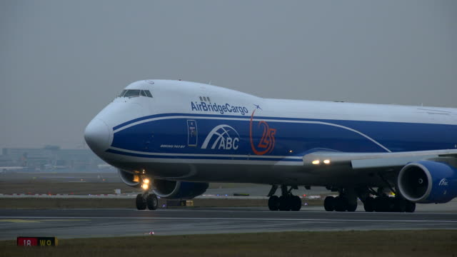 airbridge cargo boeing 747 airplane on taxiway at frankfurt airport, frankfurt am main, hesse, germany - western script stock videos & royalty-free footage