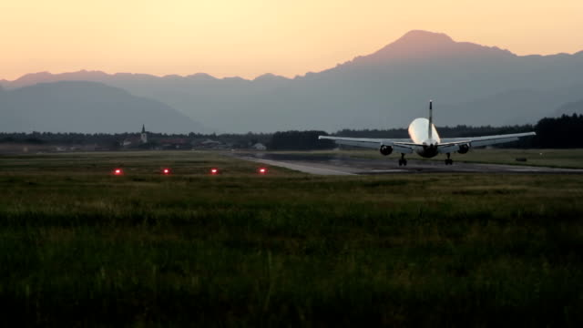stockvideo's en b-roll-footage met airbus a300 landing at ljubljana brnik airport - landen