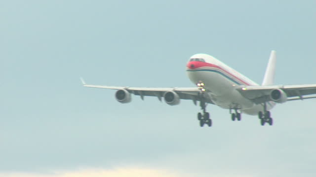 airbus a340 airplane final approach seq - vancouver canada stock videos & royalty-free footage