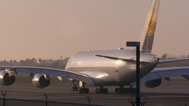 airbus a380 on runway - airbus stock-videos und b-roll-filmmaterial