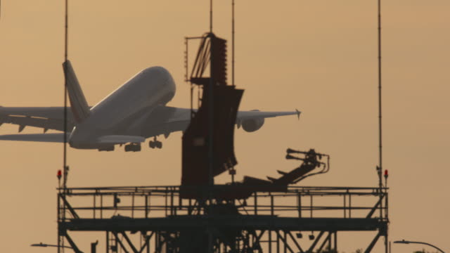 airbus a380 take-off at sunset - airbus stock-videos und b-roll-filmmaterial