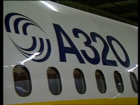 airbus airbus itn lib 18184 airbus industrie assembly plant ms interior of a320 av seating in a320 ms exterior of plane in hangar with a320 sign bv... - airbus stock-videos und b-roll-filmmaterial