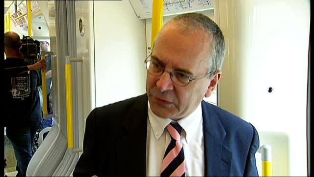 airconditioned rolling stock introduced to metropolitan line tube int peter hendy interview sot general view of passengers riding on new train - household fixture stock videos and b-roll footage