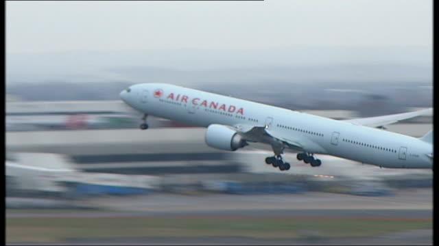 stockvideo's en b-roll-footage met aircraft at heathrow airport etihad aircraft in holding bay area/ air canada aircraft takes off/ us airways aircraft takes off/ air canada aircraft... - us airways