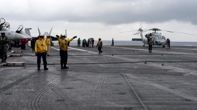 Aircraft attached to the Navy's forwarddeployed aircraft carrier USS Ronald Reagan conduct the Carrier Air Wing Five flyoff Ronald Reagan the...