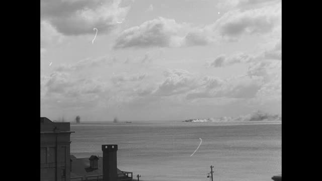 montage aircraft attacking a naval convoy in the channel and a blimp is shot down / dover, england, united kingdom - dover england stock videos and b-roll footage