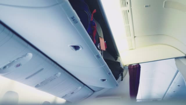 aircraft cabin on the plane - luggage stock videos & royalty-free footage