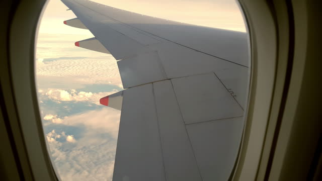 aircraft cabin window sunset - vehicle interior stock videos & royalty-free footage