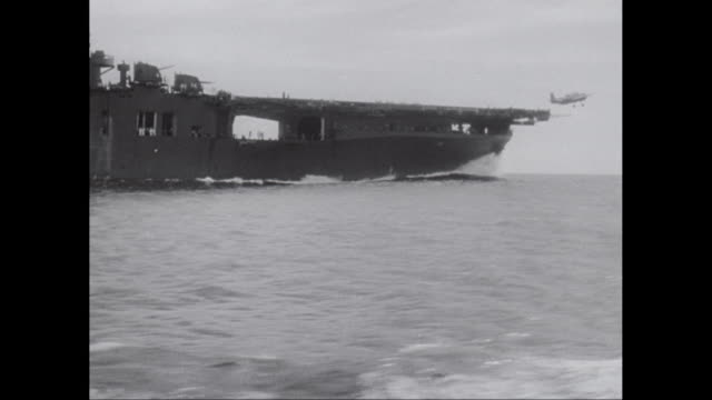 ws aircraft carrier crew and pilots prepare, launch fighter planes from deck of carrier / united states - world war ii stock videos & royalty-free footage