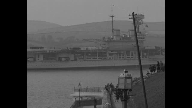 VS aircraft carrier HMS Eagle Destroyer HMS Rodney in Plymouth harbor / Note exact month/day not known