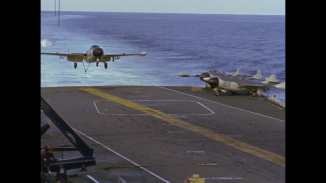 Aircraft carrier HMS Victorious - fighter planes landing on deck