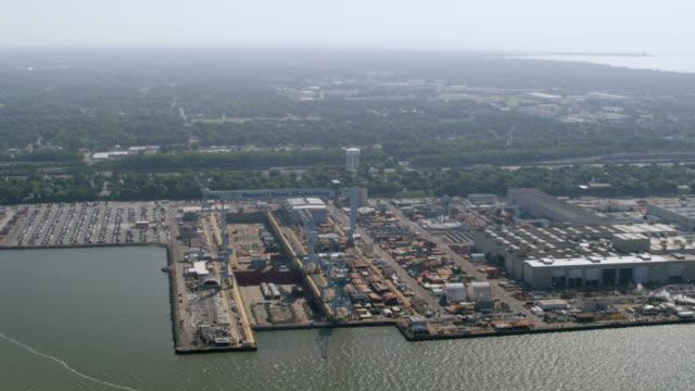 WS AERIAL POV Aircraft carrier under construction at Newport News Shipbuilding / Newport News, Virginia, United States