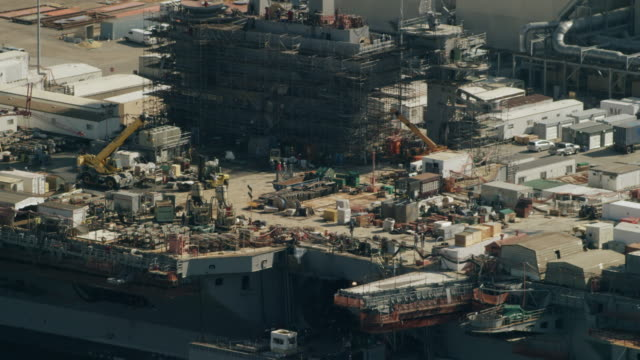 WS AERIAL POV Aircraft carrier under construction at Newport News Shipbuilding / Newport News, Virginia, United States