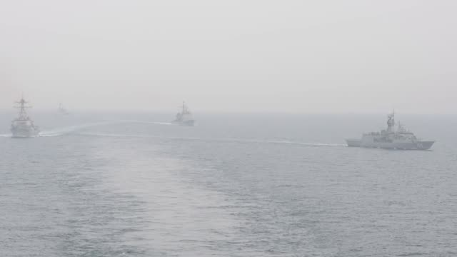 aircraft carrier uss john c. stennis sails in formation with guided-missile destroyer uss spruance , guided-missile cruiser uss mobile bay , royal... - 米国海軍点の映像素材/bロール