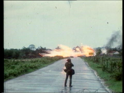 LIB US aircraft dropping napalm PAN Kim Phuc little girl burnt by napalm running along road PAN