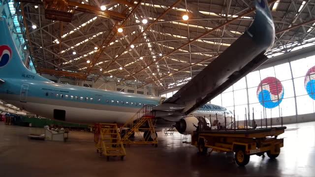Aircraft engineers checking Koreanair Airplane in Airplane Hangar