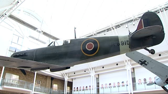 stockvideo's en b-roll-footage met aircraft enthusiasts at imperial war museum england london imperial war museum photography** aircraft enthusiasts posing in front of spitfire plane... - imperial war museum museum