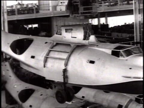 aircraft fuselage being carried on an assembly line in a plant / naval aircraft factory, philadelphia, pennsylvania, united states - air vehicle stock videos & royalty-free footage