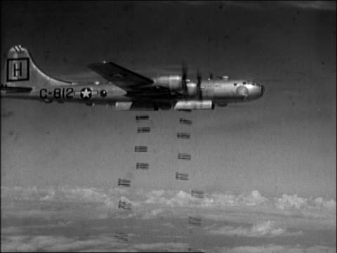aircraft in flight, dropping bombs; c-812 and united states air force logo on side of aircraft. - b29 stock videos & royalty-free footage
