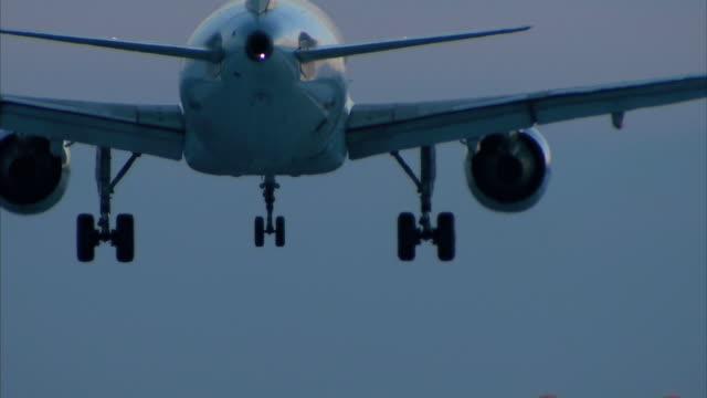 aircraft landing at night - landing touching down stock videos & royalty-free footage