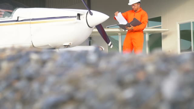 aircraft maintenance by engineer or technician inspects with clipboard - private airplane stock videos & royalty-free footage