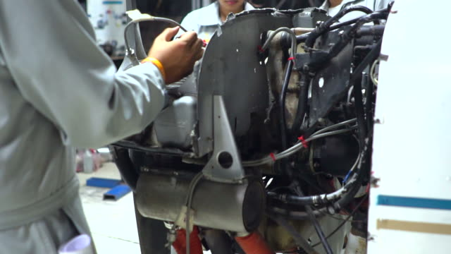 aircraft maintenance by young engineer or technician inspects airplane jet engine - air vehicle stock videos & royalty-free footage